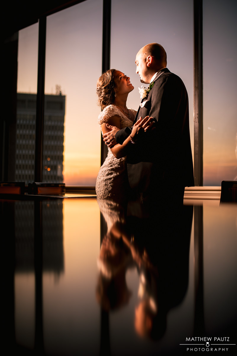 Bride and groom in front of beautiful sunset over Greenville SC Skyline
