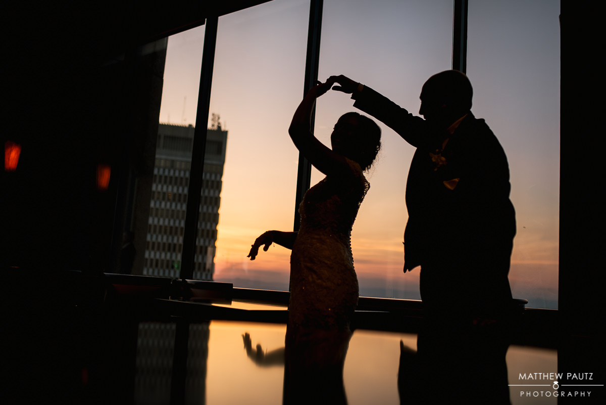silhouette of bride and groom dancing at the commerce club