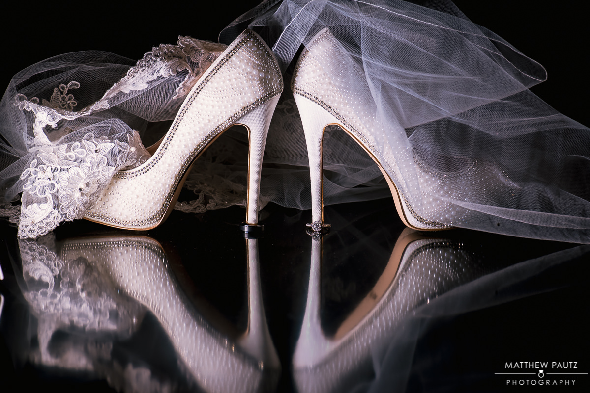 wedding shoes and veil on black background