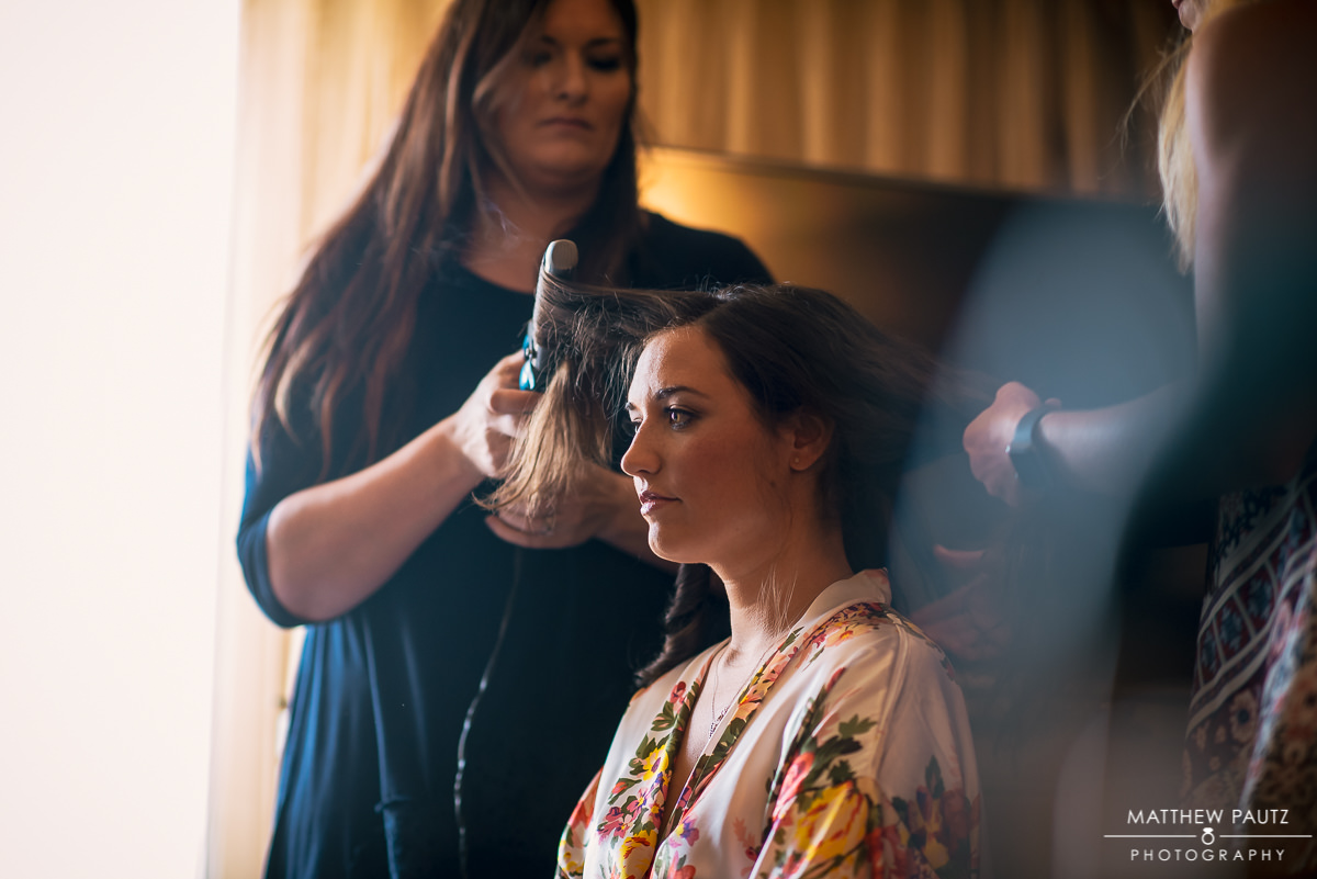 bride getting ready with hair and makeup before wedding