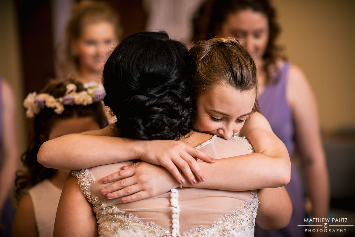 bridesmaid seeing bride dressed for first time