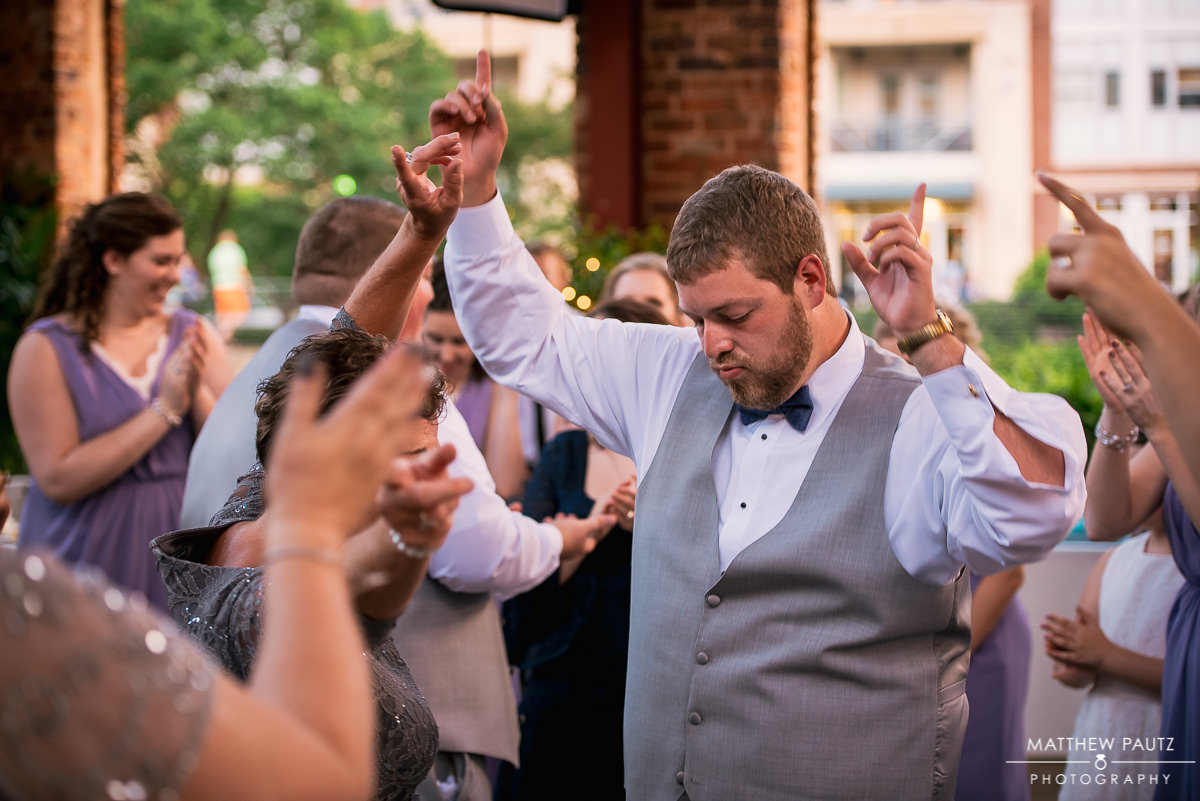 Groom dancing at wedding reception