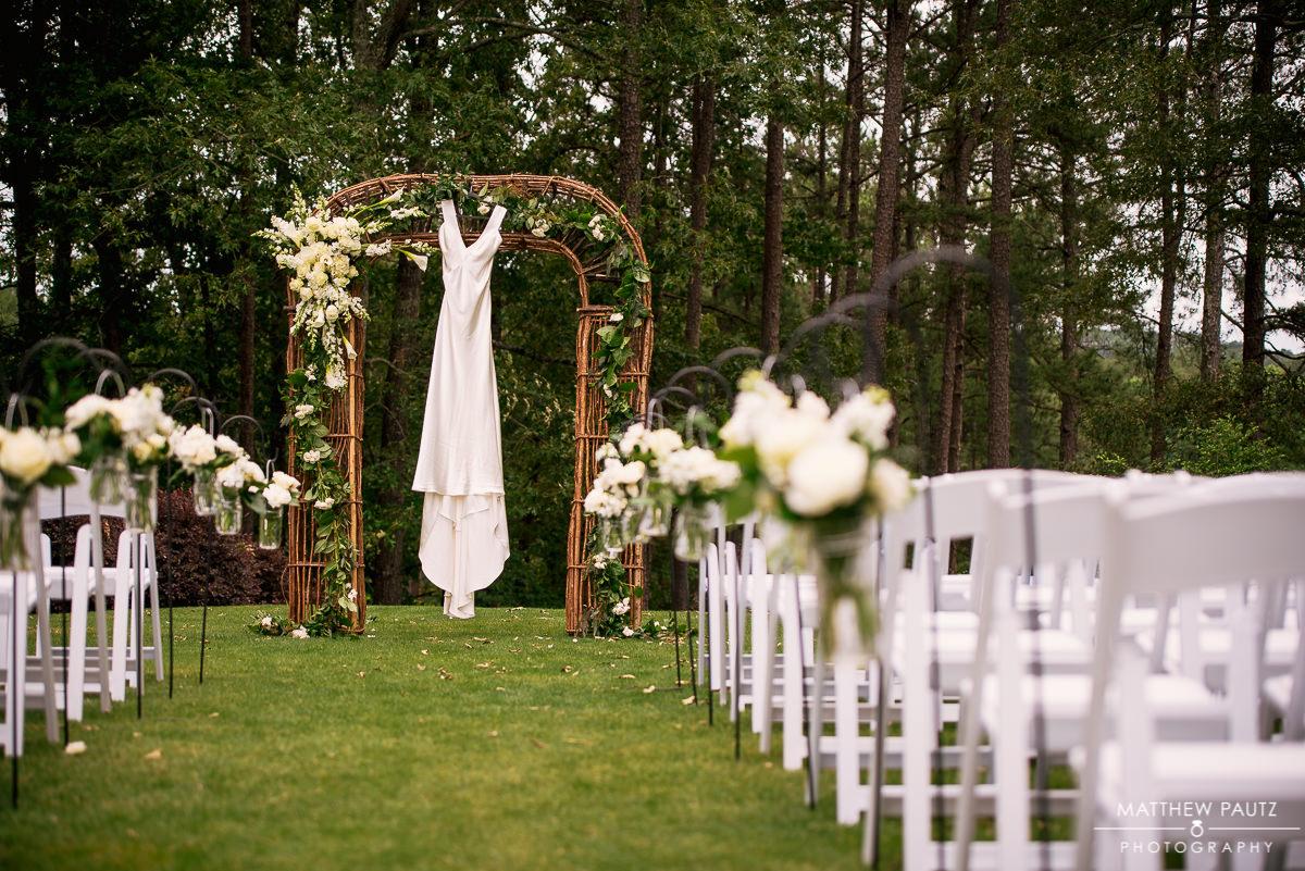 wedding dress hanging outside at wedding ceremony location