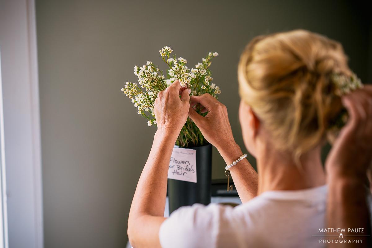 bride choosing flowers to put in her hair