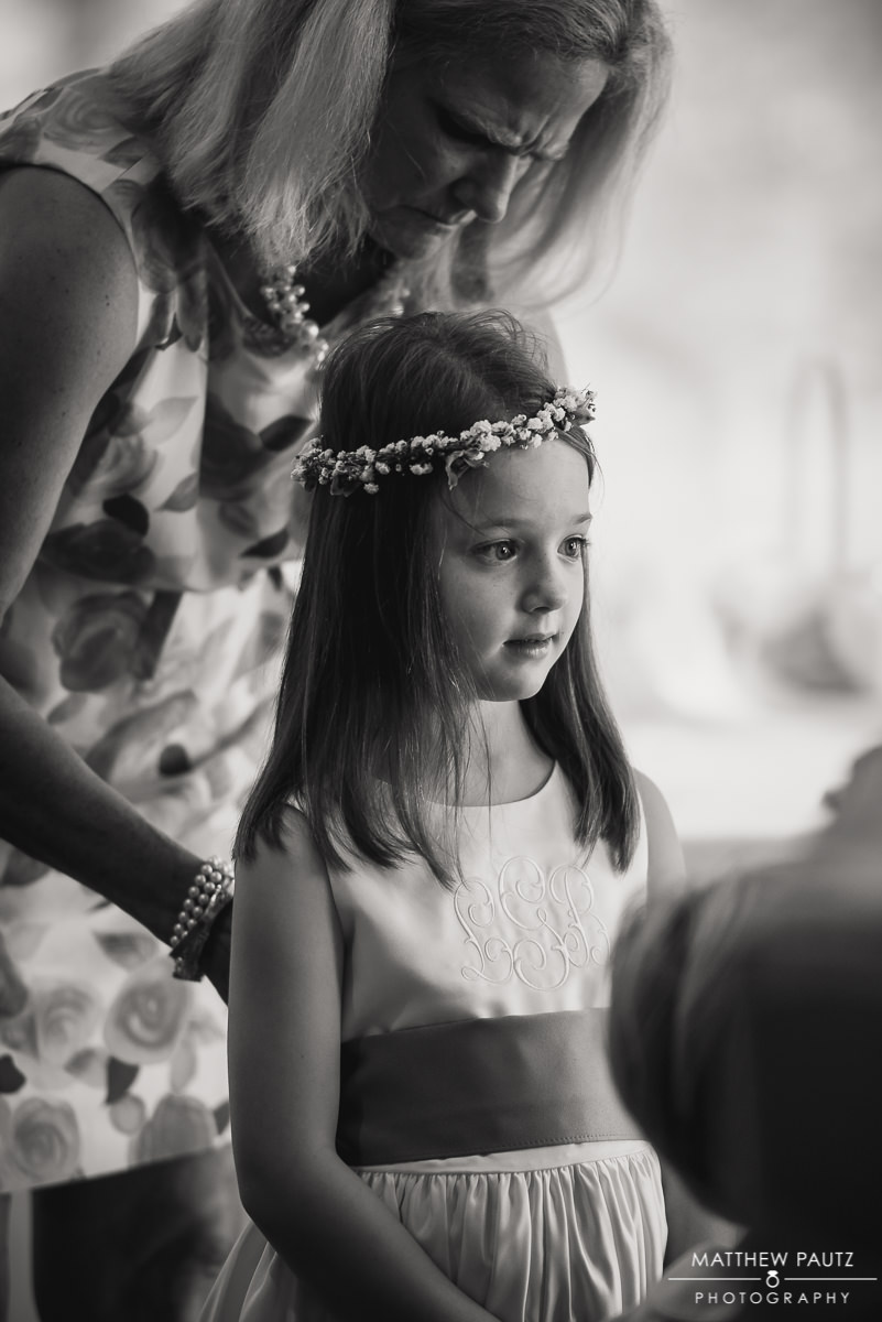 flower girl getting ready for wedding reception