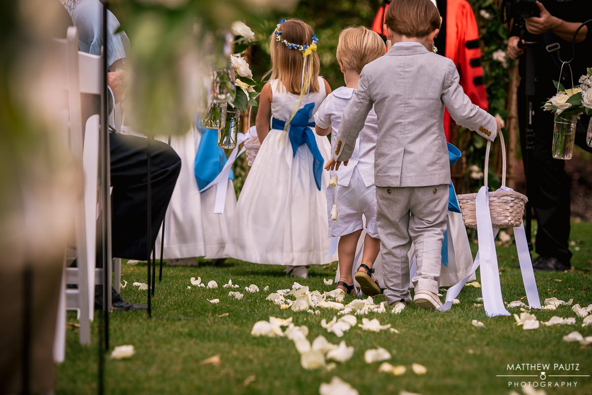 children dropping flowers at wedding reception