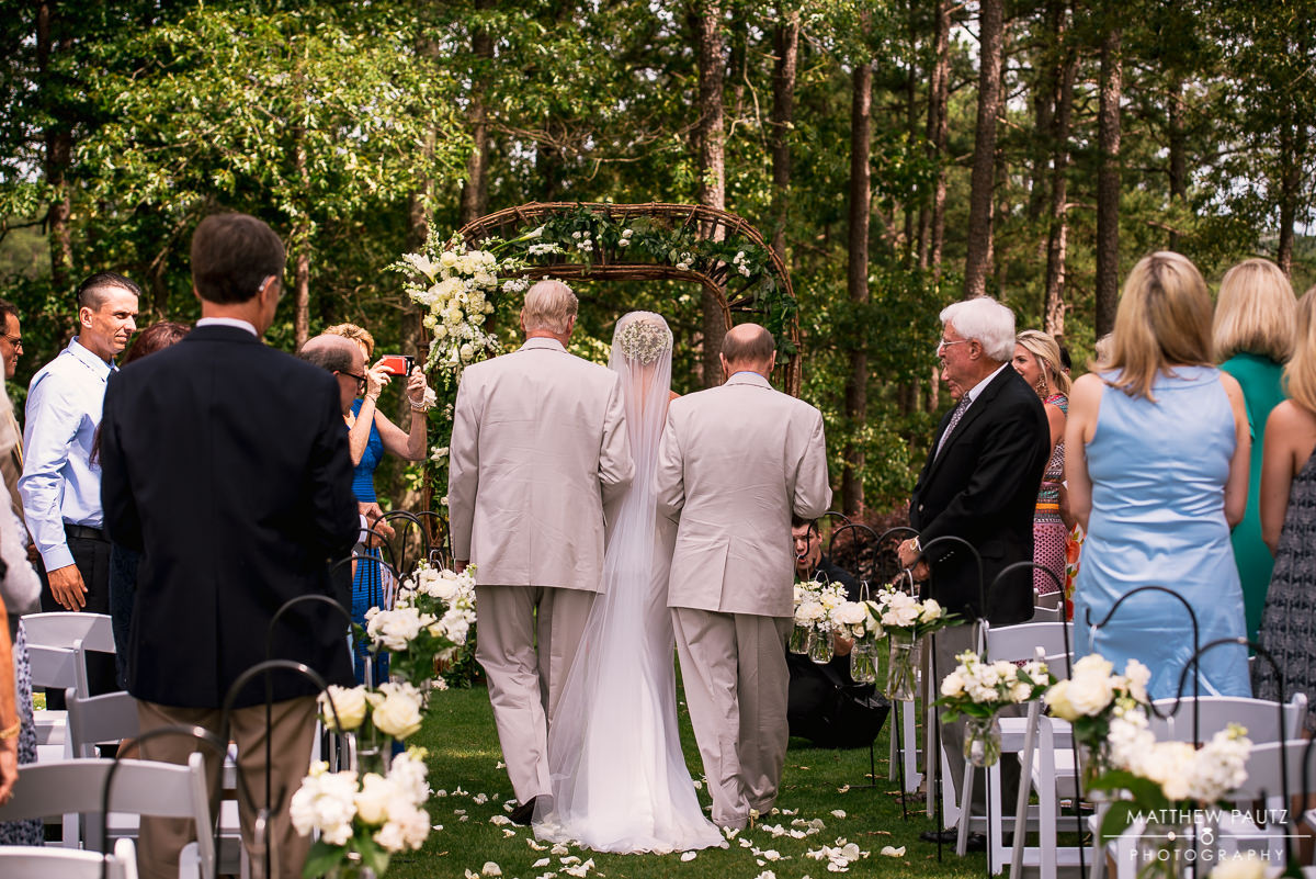 Bride walking down the aisle at outdoor wedding ceremony