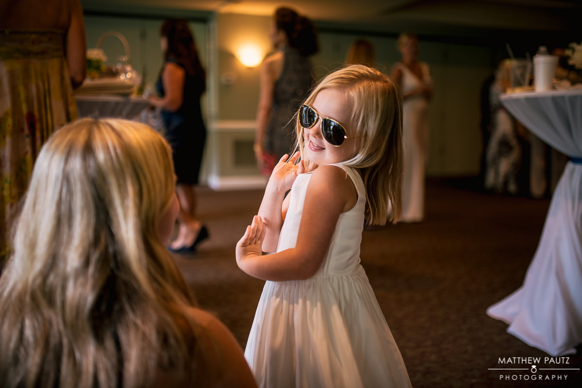 flower girl striking a pose with sunglasses