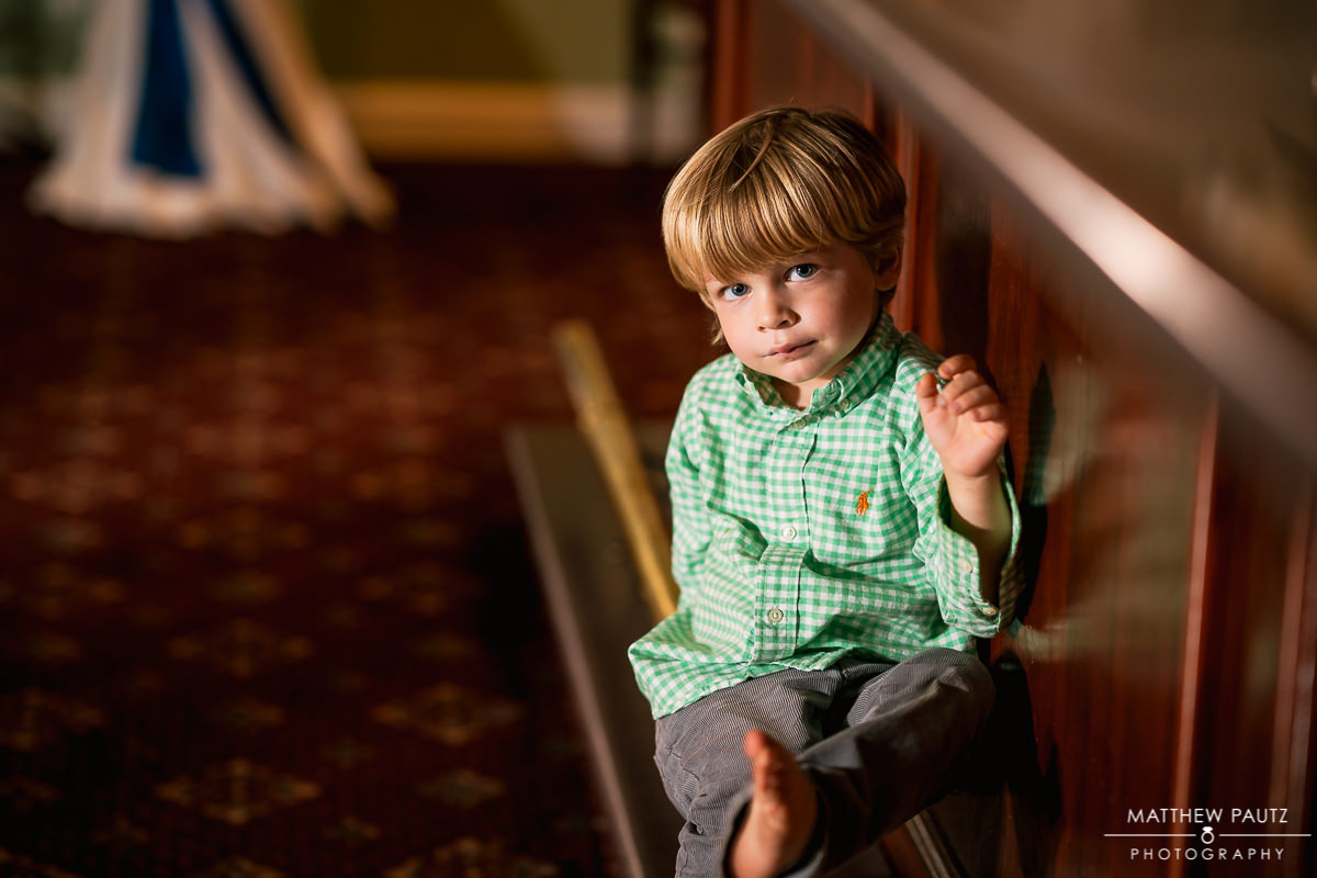 child sitting down during wedding reception