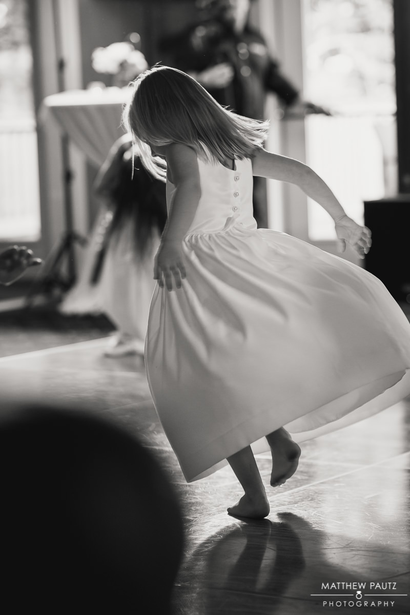 flower girl dancing at wedding reception