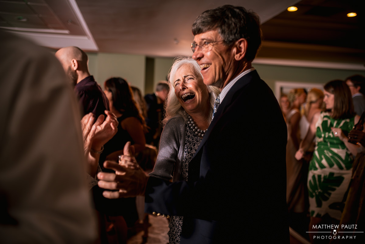 wedding guests dancing and having fun at reception