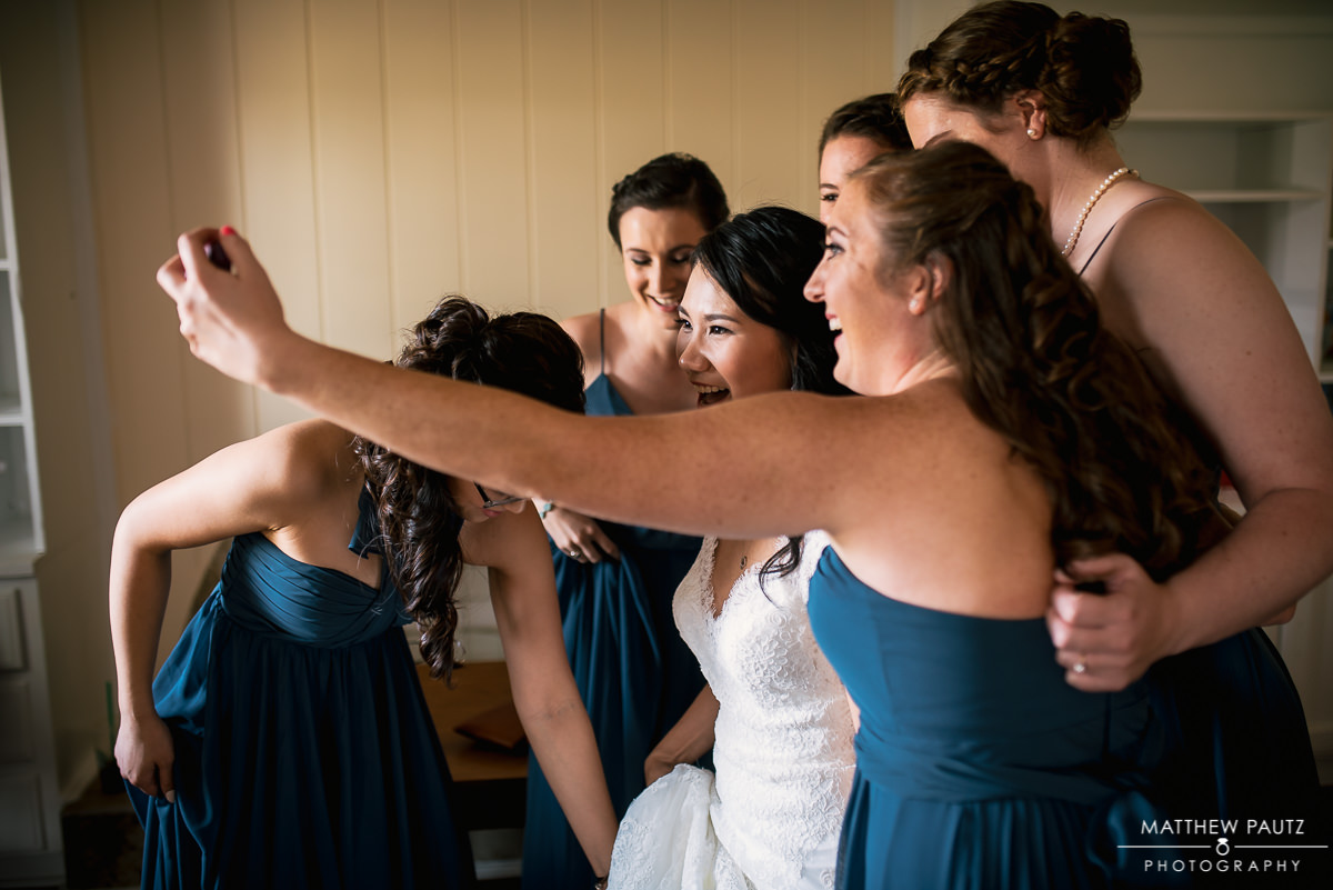 bride taking selife with bridesmaids