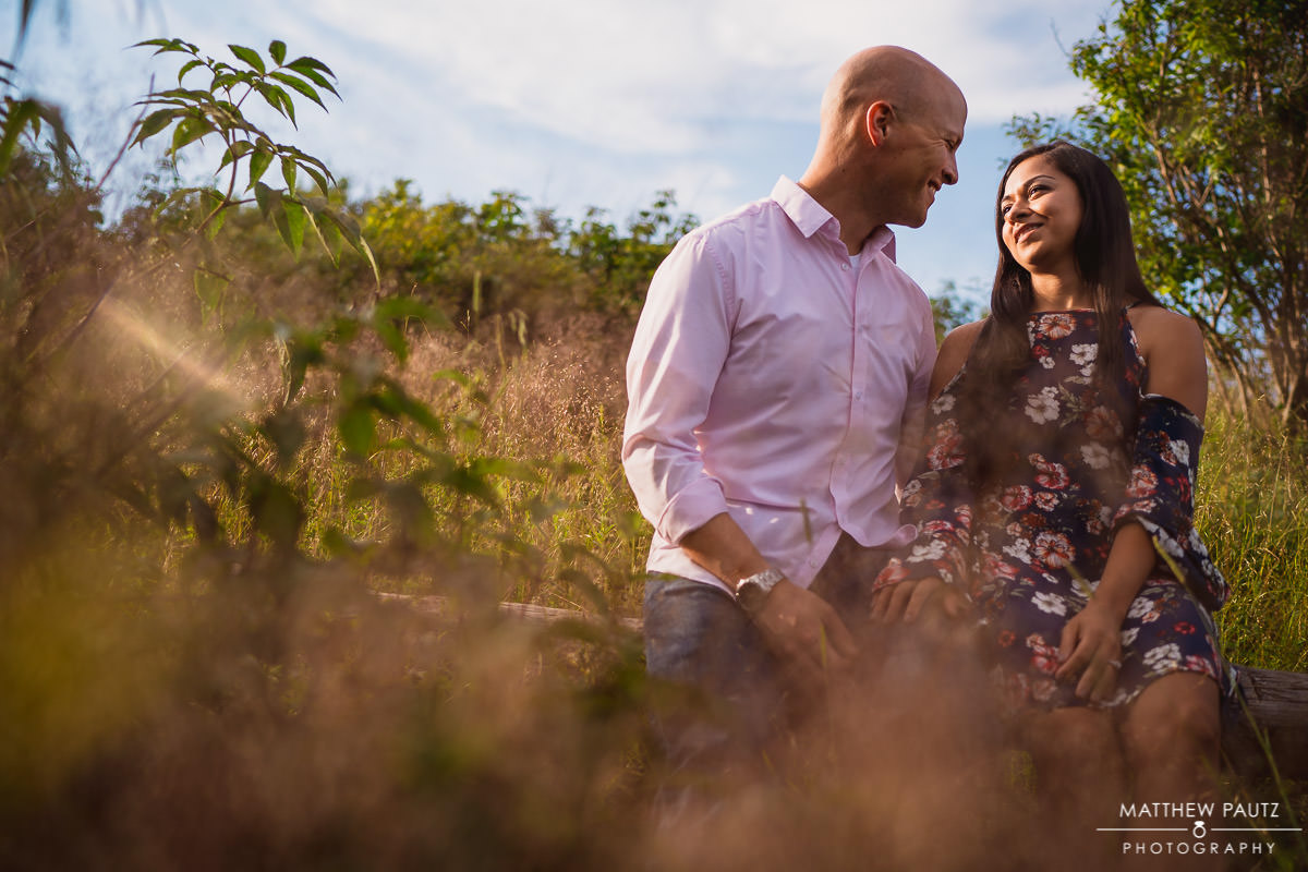 mountain engagement photo in tall grass