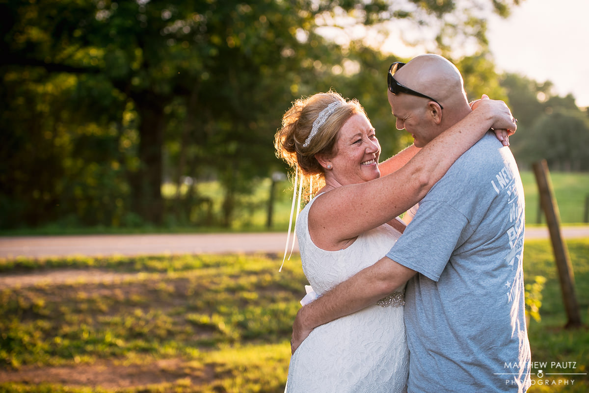 newly couple dancing at sunset at city scape winery