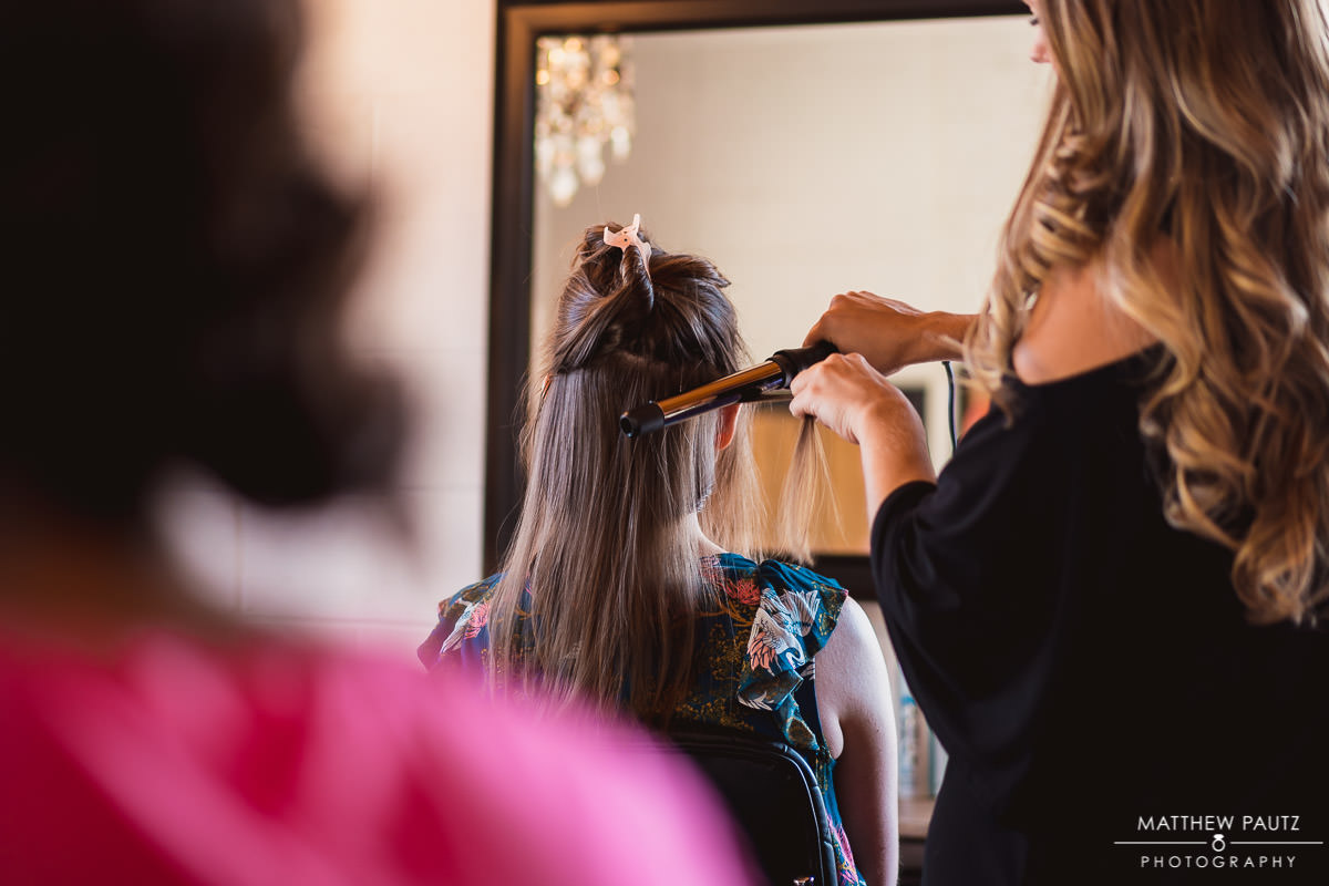 bride getting hair styled at Lashbar in greenville