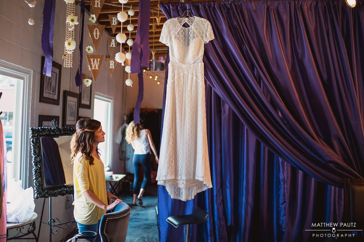 wedding dress hanging at salon before ceremony