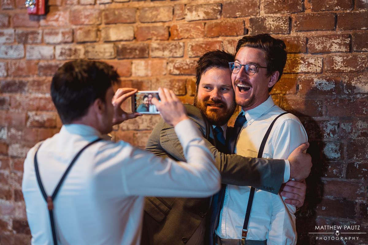 groomsmen taking funny photos