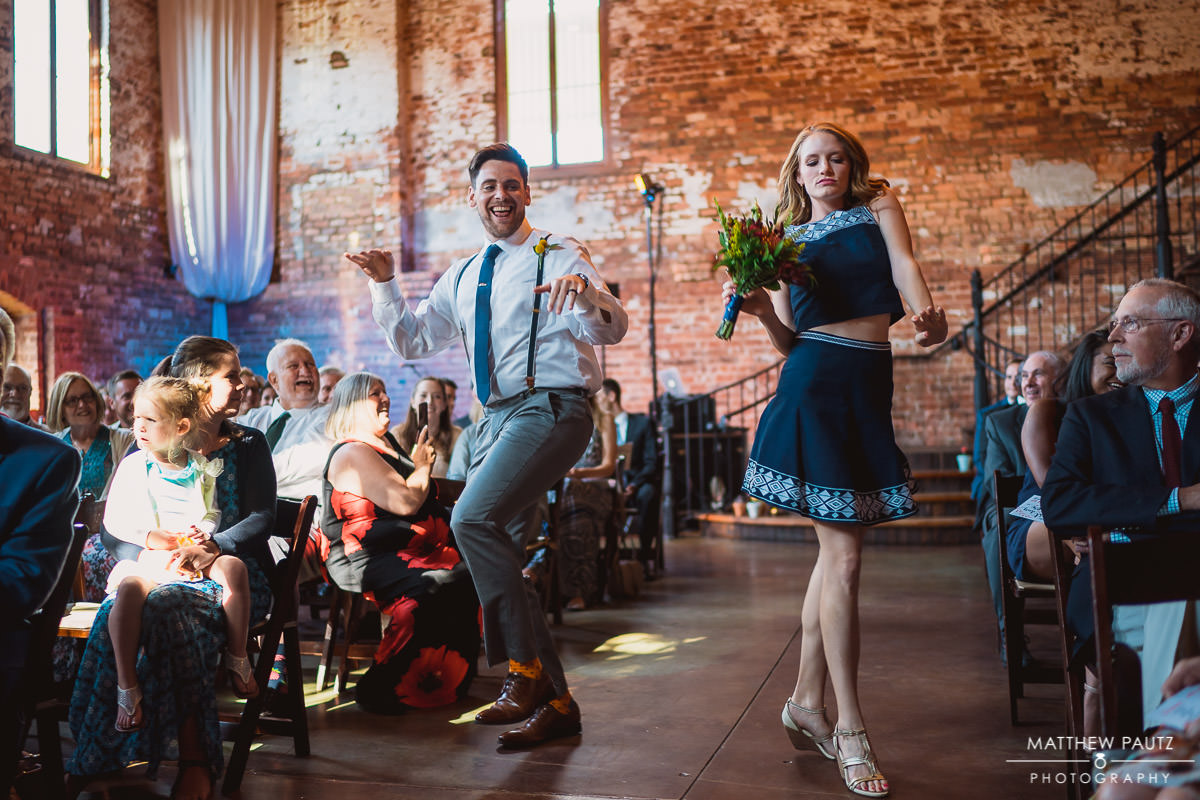 wedding party dancing down aise at old cigar warehouse