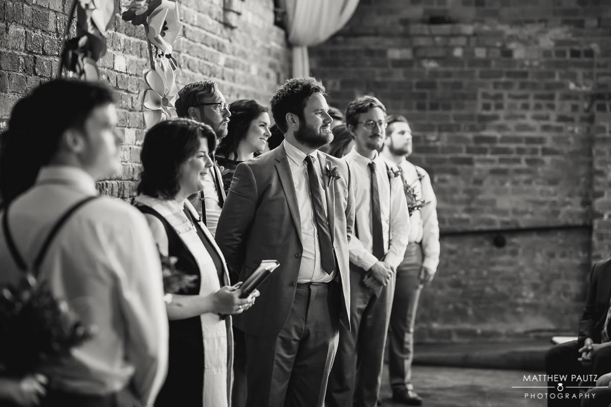 groom seeing bride for first time at wedding ceremony