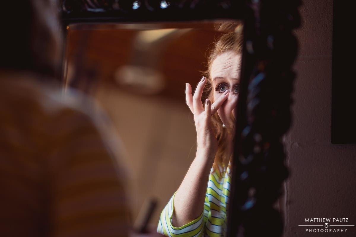bridesmaid adjusting eye makeup