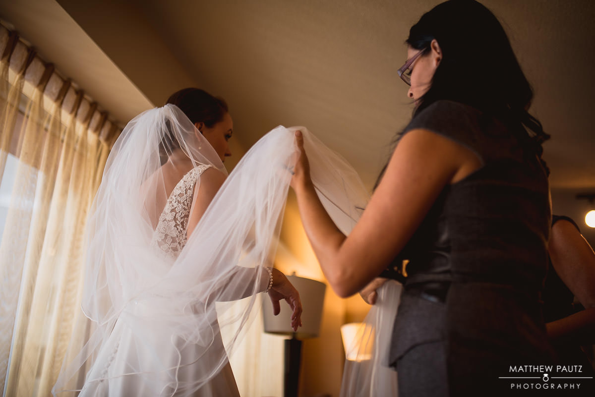 bride getting her veil placed