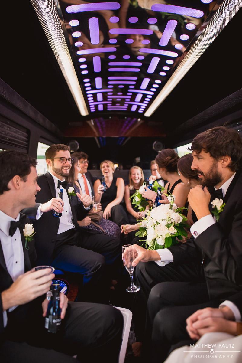 bridal party having fun in wedding limo