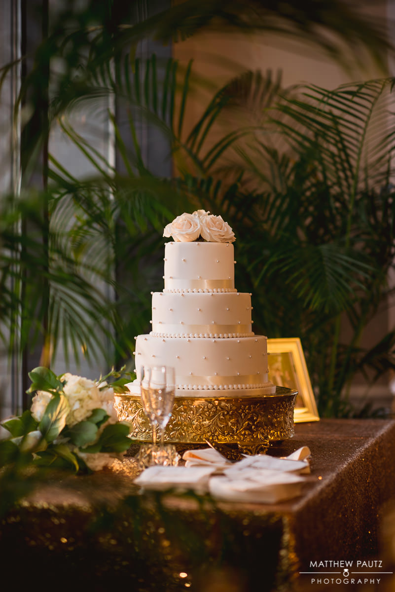 Beautiful wedding cake on display for wedding reception at The Commerce Club Greenville