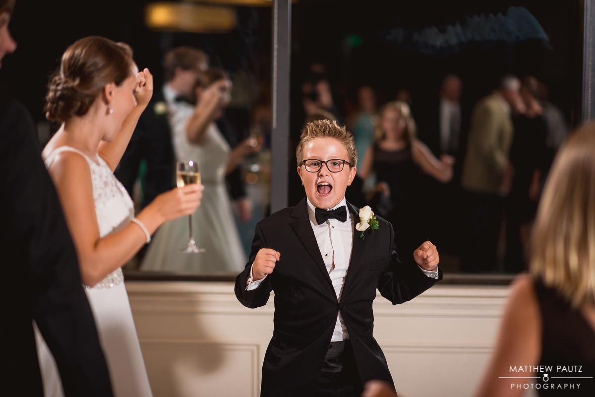 Child dancing at wedding reception