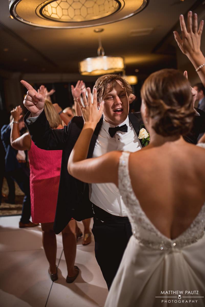 Bride and groom having fun on dance floor
