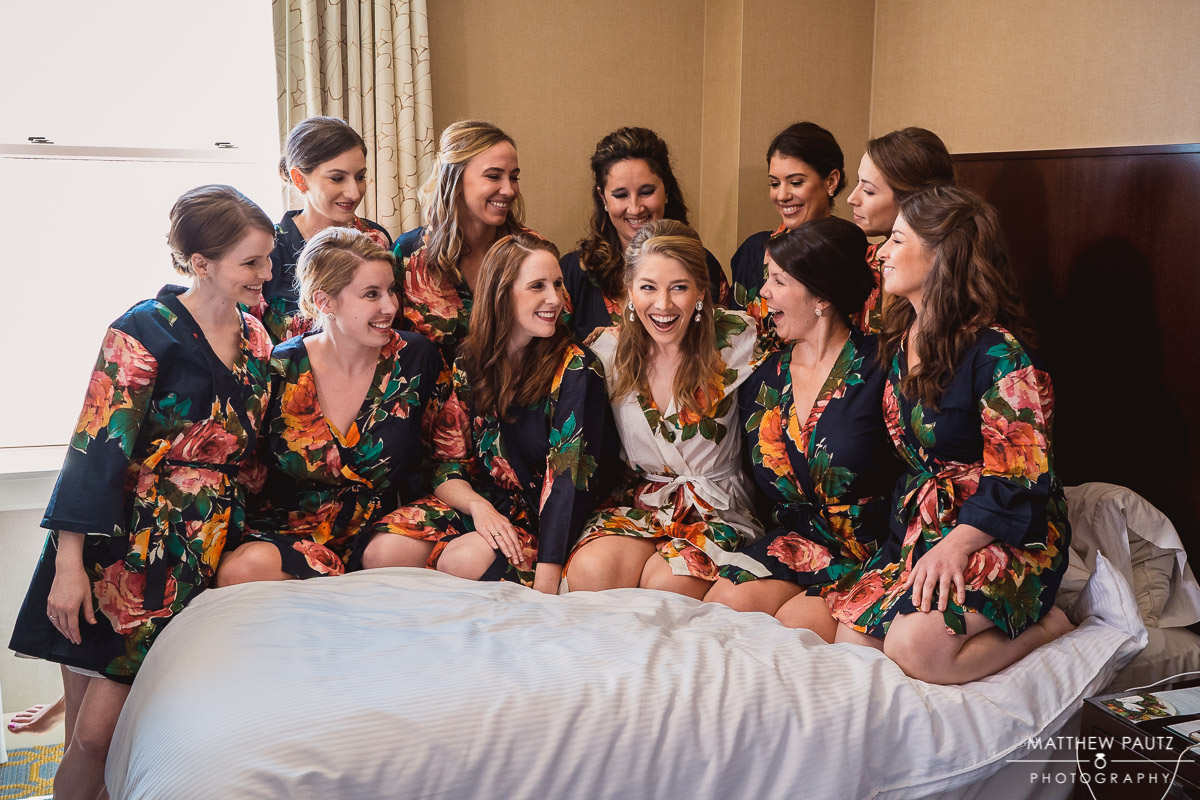 group of bridesmaids hanging out in hotel room
