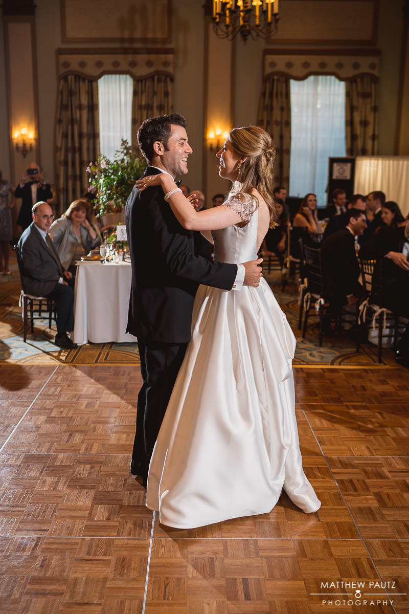 bride and groom's first dance together at wedding reception