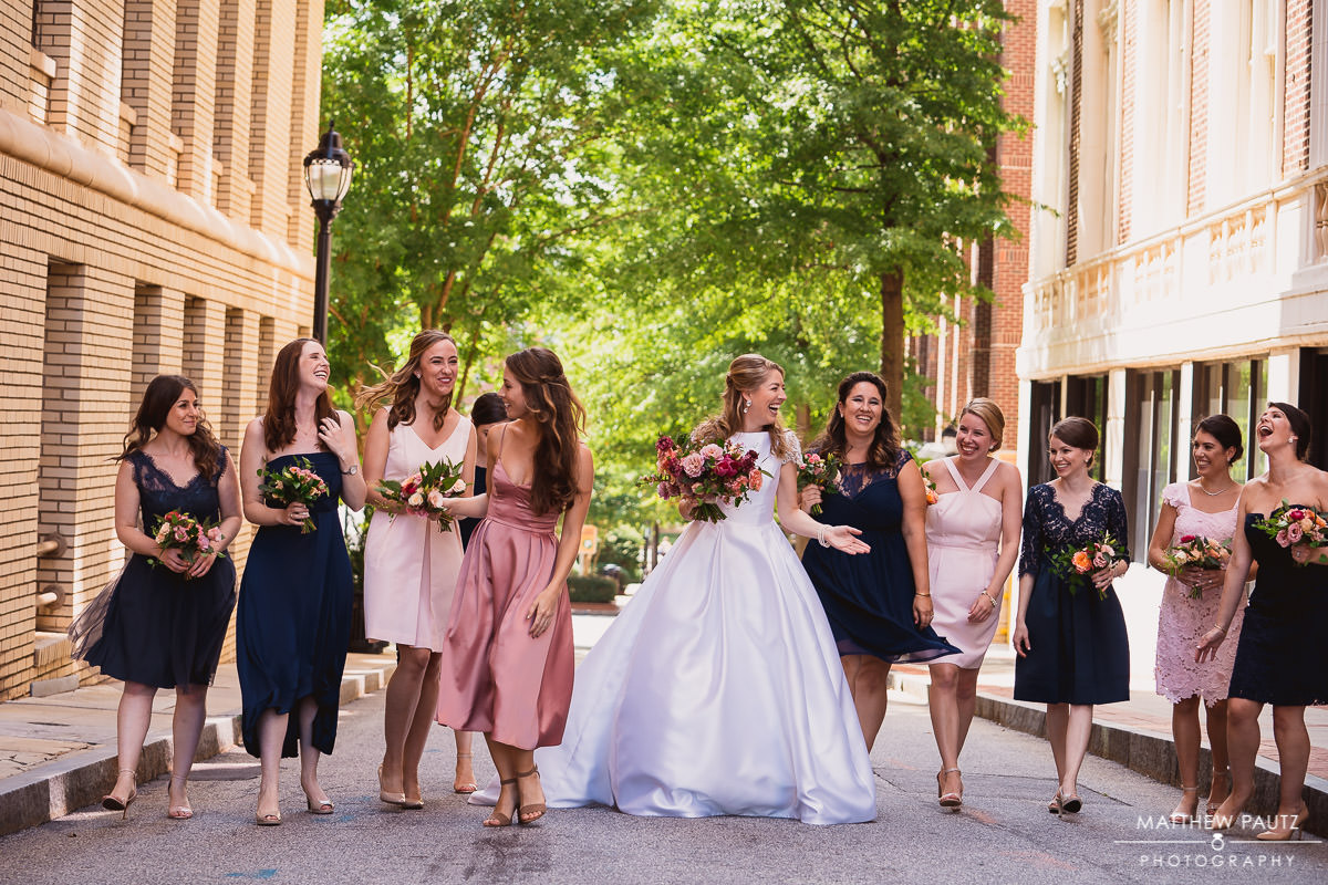 Bride walking in a line with her bridesmaids before wedding