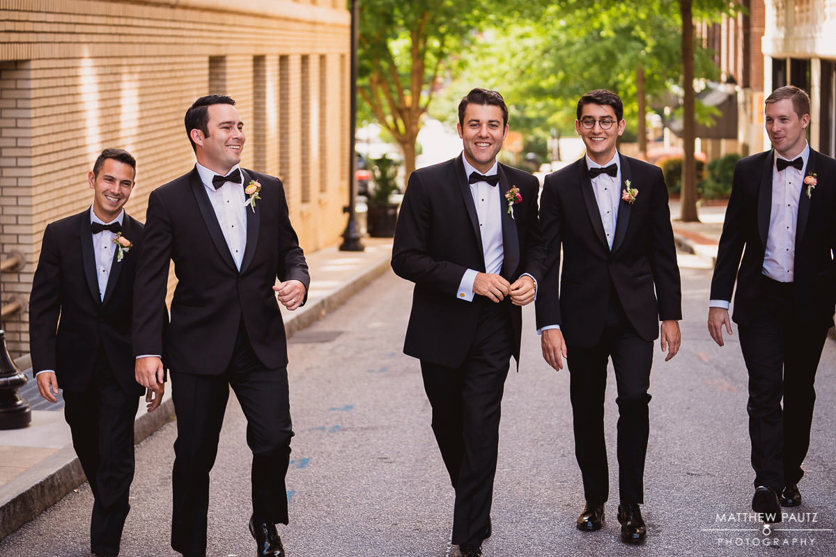 Groom walking with his groomsmen in a line