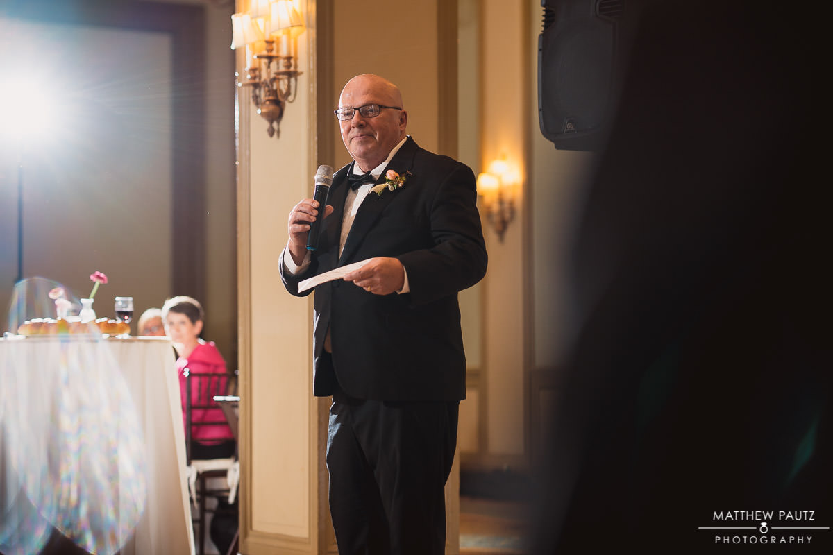 Father of the bride giving toast at wedding ceremony