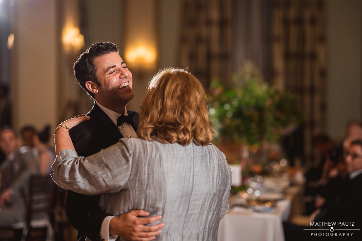 Groom dancing with his mother on wedding day