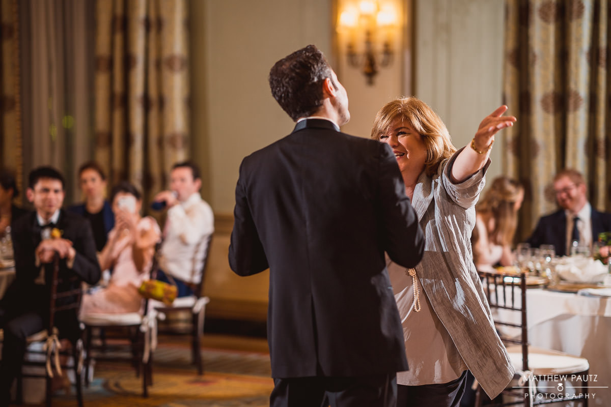 Groom and his mother dance during wedding