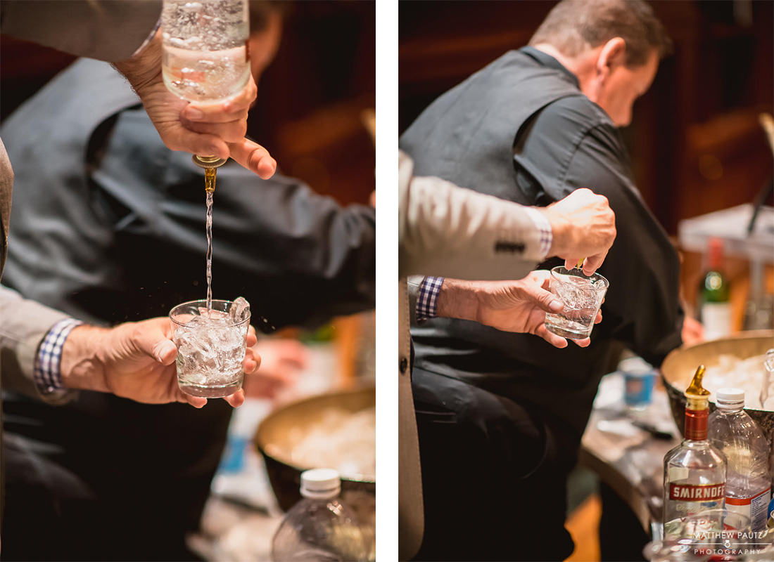 Bartender pouring drinks at wedding reception