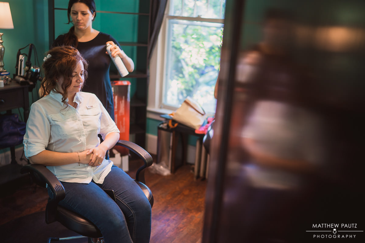 A bride getting her hair done before wedding