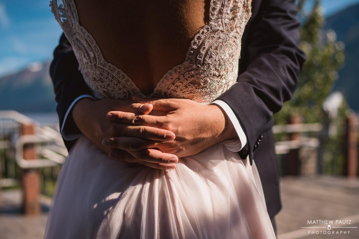 Closeup of bride hugging groom