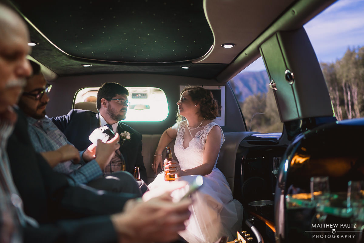 newlywed couple sharing limo ride together after ceremony