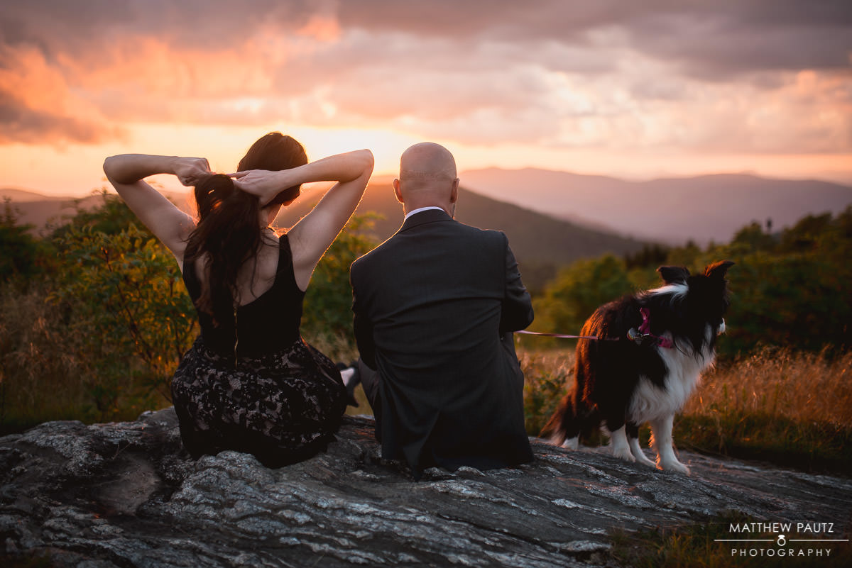 engaged couple at sunset with dog