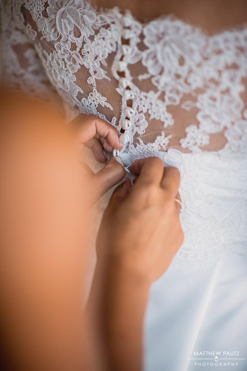 bride finishing getting dressed