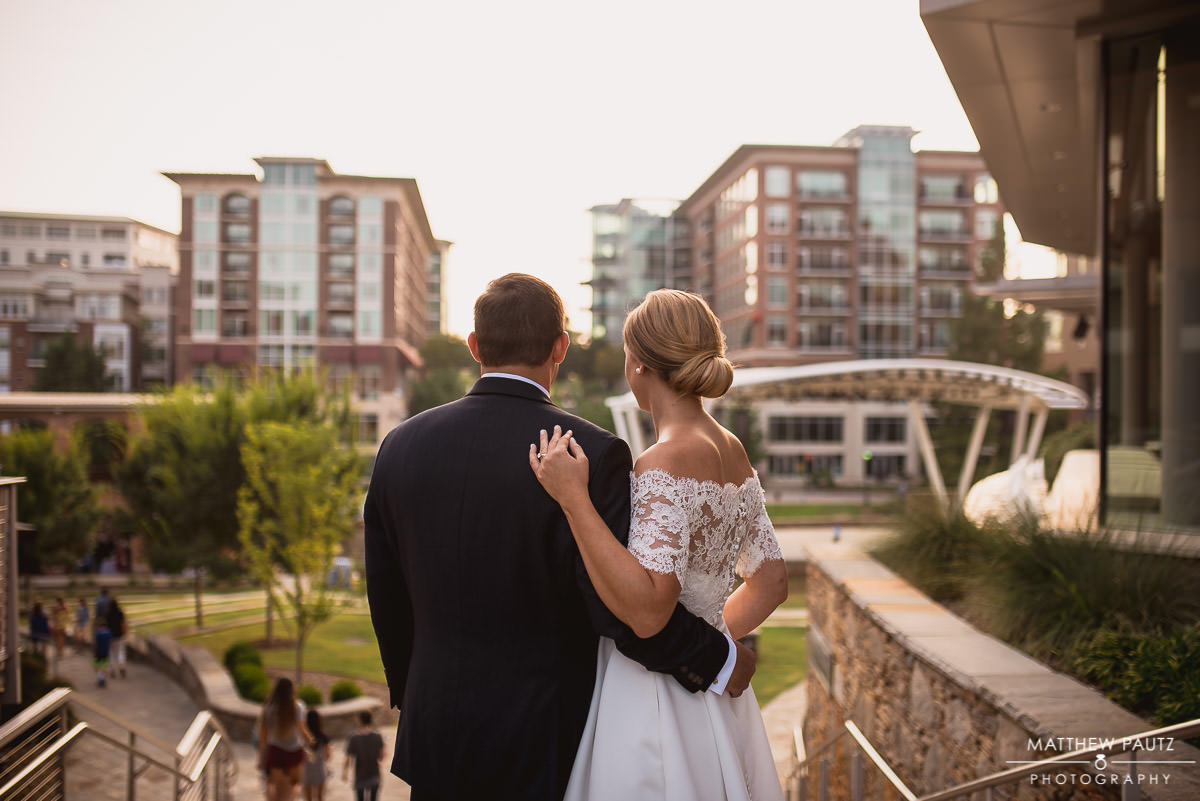 newly married couple looking over downtown greenville skyline