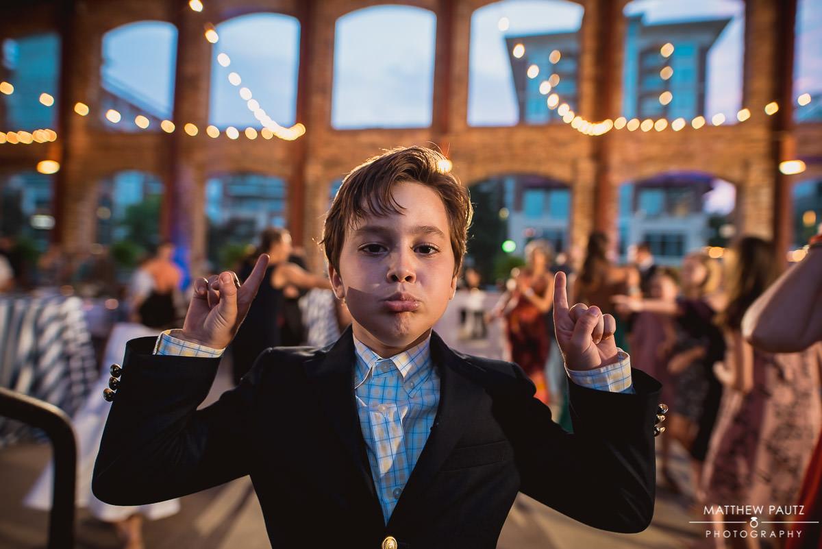 kid dancing funny at wedding reception