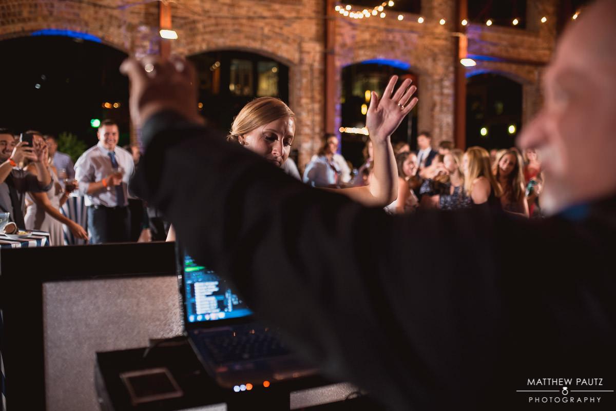 bride having fun with reception DJ