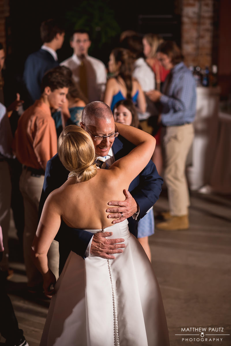 father dancing with bride at reception