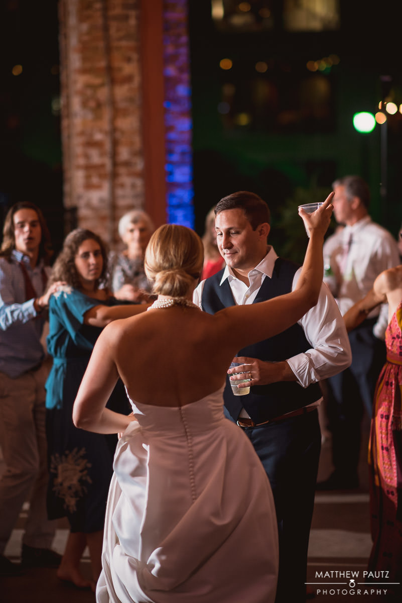 newlywed couple dances at reception
