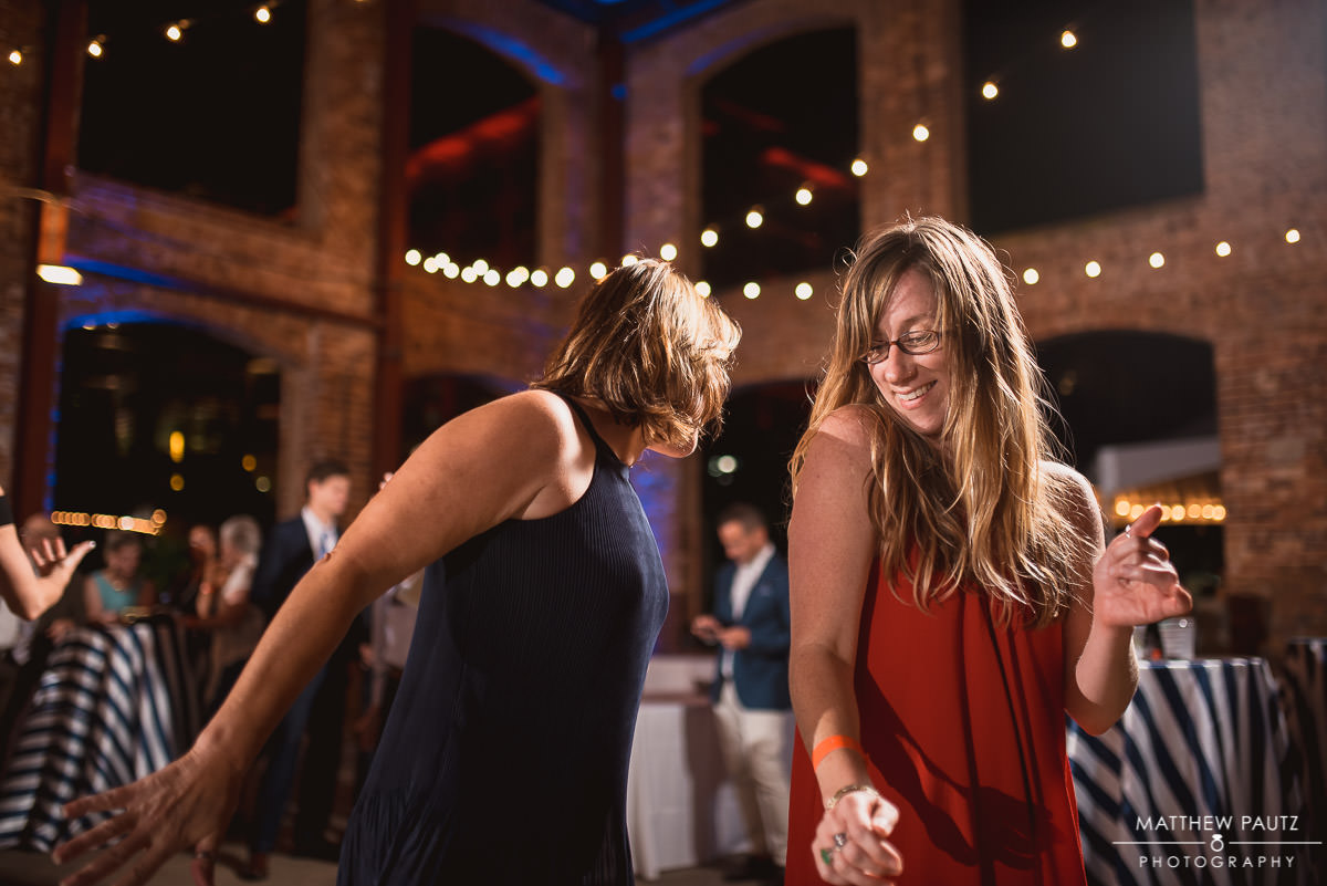 wedding guests dancing and playing around