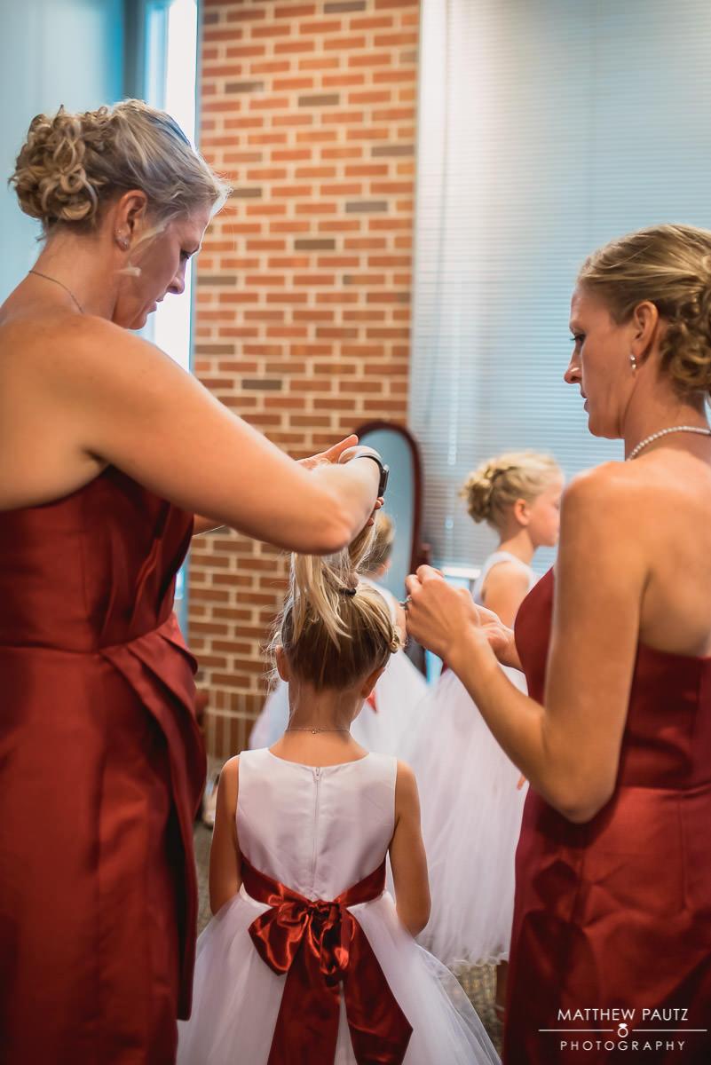 Bridesmaids getting ready at Catholic church