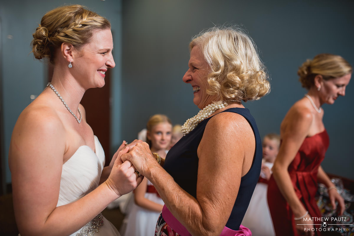 bride and her mother laughing and having fun before wedding